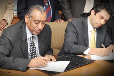 Left to right: Deputy GM at ONB; Mr. Najm Eldding M. Agab, and Executive Director for Business Development of ICSFS; Mr. Wael Malkawi.