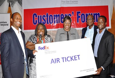 (L-r): Sule Umar Bichi, managing director, Red Star Express, Ms. Ejine Nzeribe, Author of Inspiring Growth: the history of Red Star Express,; Ms. Binta Max-Gbinije, chief executive officer, Stanbic IBTC Trustees Ltd, Muyiwa Olumekun, executive director, Red Star Express Plc, and Ademola Adepegba of Greenlife Pharmaceuticals Ltd and the st prize winner of the raffle draw held at the 2013 Red Star Express Customers Forum in Lagos