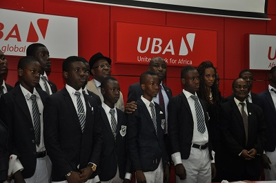 Pix of UBA Foundation's 2013 National Essay Competition 4: Divisional Head, Marketing and Corporate Relations, UBA Plc, Mr. Charles Aigbe; Managing Director, UBA Foundation, Ms. Ijeoma Aso; Vice Principal, Kings College, Mr. Charles Utomi ; and a judge and Professor Ralph Akinfeleye, with students of Kings College, Lagos,  during the press launch announcing Call for Entries for 2013 UBA Foundation National Essay Competition for Secondary Schools in Nigeria, held in Lagos recently