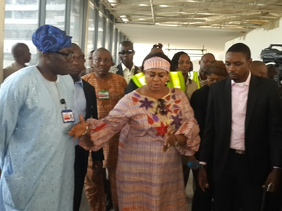 picture: Princess Stella Oduah, minister of Aviation flanked by officials of the ministry and FAAN while on an inspection tour of MMIA 'D' and 'E' fingers in Lagos on Tuesday.