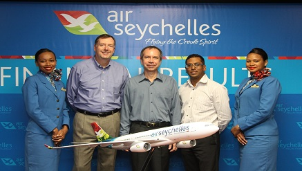 (L-r): Kevin Knight, vice chairman, Air Seychelles, Joël Morgan, Seychelles minister for Home Affairs and Transport and Air Seychelles Board Chairman, Manoj Papa, chief Executive officer, flanked by air-hostesses, during its report presentation recently.
