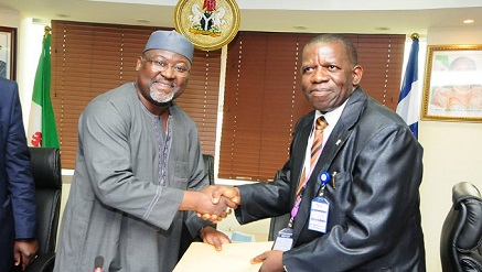 "(L-r): Engr. Ubale Maska, executive commissioner, Technical Services who represented the EVC and Dr. Victor Olugbemiga Matthews of the Covenant University during the presentation of the grant Of Two Million Five Hundred Naira To The Lead Researcher On ""Implementation Of A Software-Based Nomadic Base Station (NBS)"