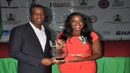 """(L-r): Chukwuma Ochonogor, managing director and chief executive officer, and Chidinma Onyeokoro, head, Strategy and Marketing, both from Rosabon financial Services Limited, immediately after receiving """"Quality Service Award"""" bestowed on the company by the Institute for Government Research, Leadership and Technology, Abuja, recently."""