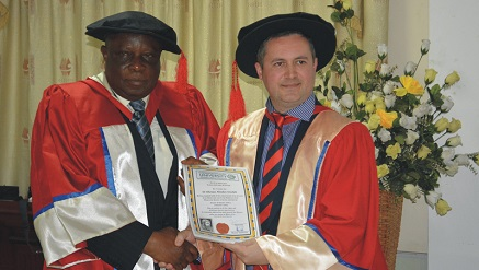 L-r: Oluropo Owolabi, managing director/chief executive officer of Skyway Aviation Handling Company Limited receiving the degree